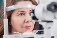 woman getting eyes examined
