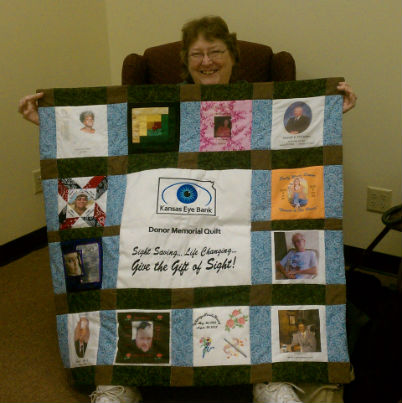 Woman holding a quilt