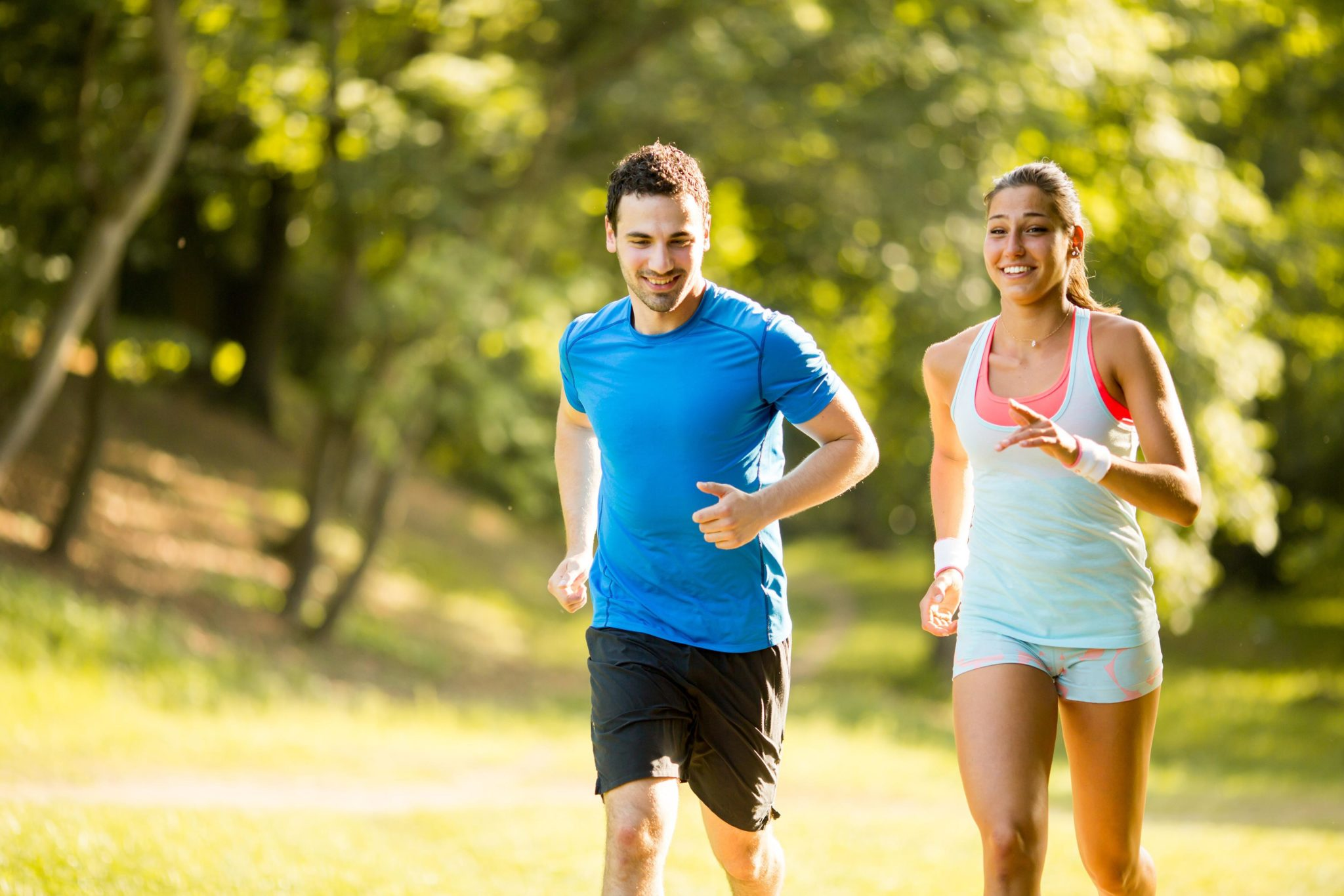 a man and women jogging outside