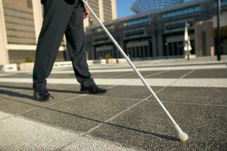 Blind person walking with a cane