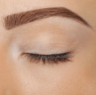 Close up image of a woman's eyebrow and eye