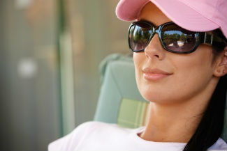 Woman wearing a hat and sunglasses